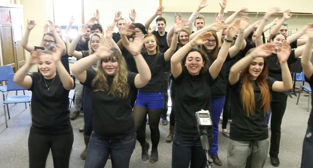 Members of the Deering High School choir rehearse for an appearance with Foreigner in a sold-out show next Tuesday at the State Theatre.