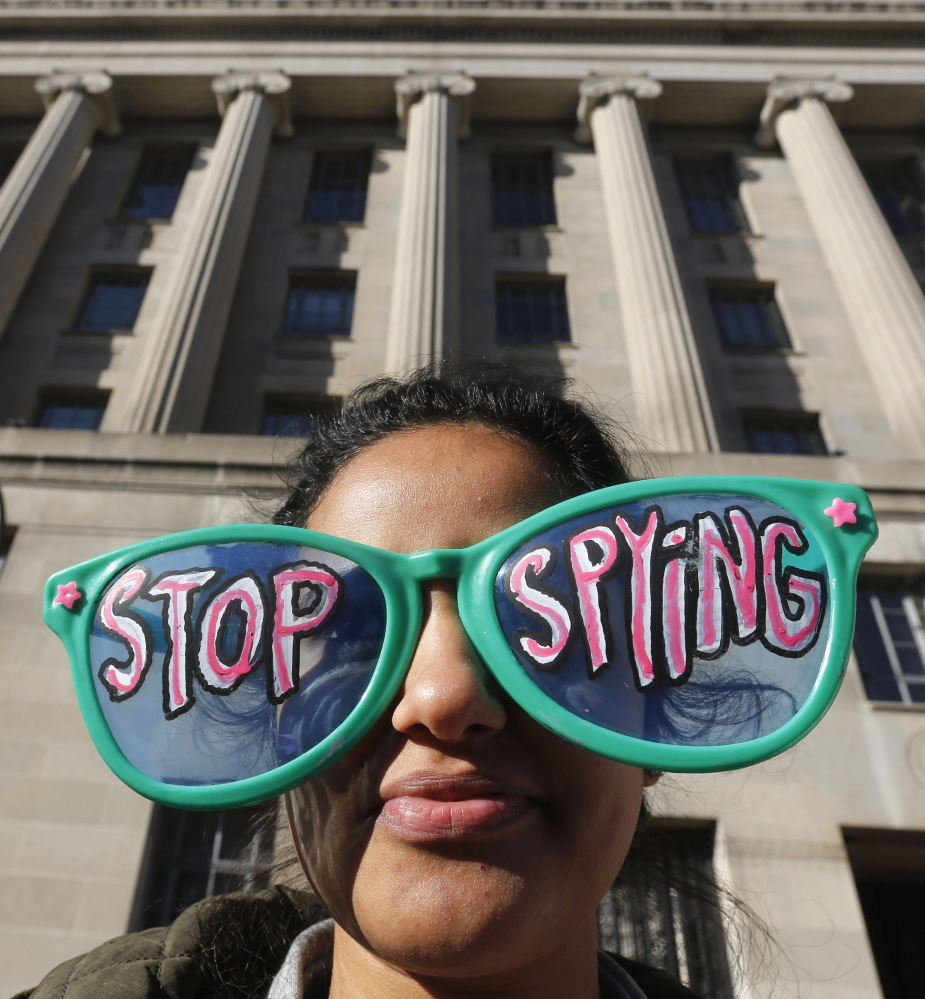 A member of the protest group Code Pink, Sarah Harbi, demonstrates outside the Department of Justice last month.
