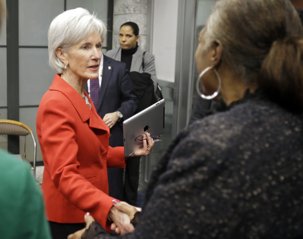 FILE - In this Feb. 3, 2014 file photo, Health and Human Services Secretary Kathleen Sebelius greets visitors after a news conference on enrollment in affordable health coverage in Cleveland. The Obama administration says about 1 million Americans signed up for private insurance under the presidentís health care law in January, extending a turnaround from early days when a dysfunctional website frustrated consumers. New numbers released Tuesday show nearly 3.3 million people signed up through Feb. 1. Although enrollment is gaining ground, the governmentís initial target of 7 million by the end of March still seems like a stretch. (AP Photo/Mark Duncan, File)