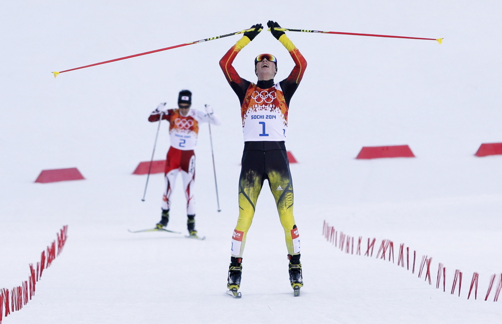 Germany's Eric Frenzel celebrates winning the gold after the cross-country portion of the Nordic combined at the 2014 Winter Olympics