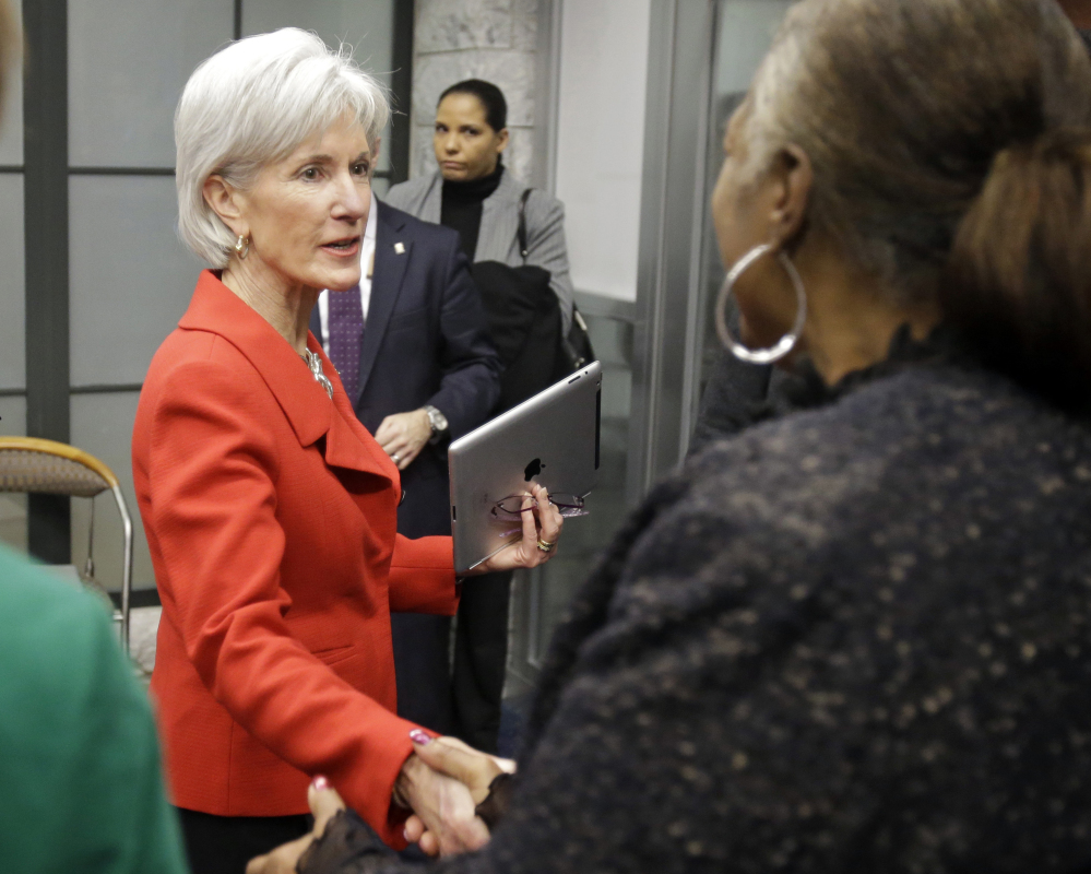 Health and Human Services Secretary Kathleen Sebelius greets visitors after a Feb. 3 news conference on enrollment in affordable health coverage in Cleveland.