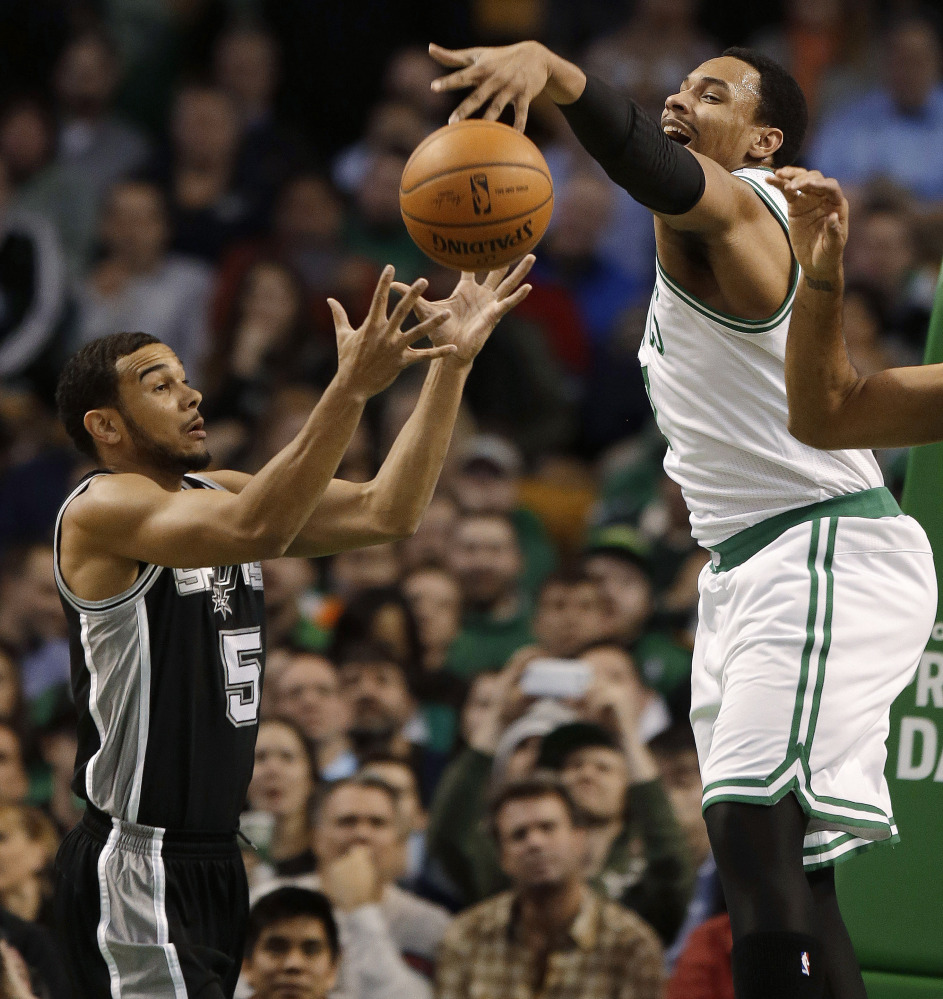 Jared Sullinger of the Boston Celtics, right, can't hang onto an offensive rebound as the ball falls into the hands of San Antonio point guard Cory Joseph. San Antonio won, 104-92.
