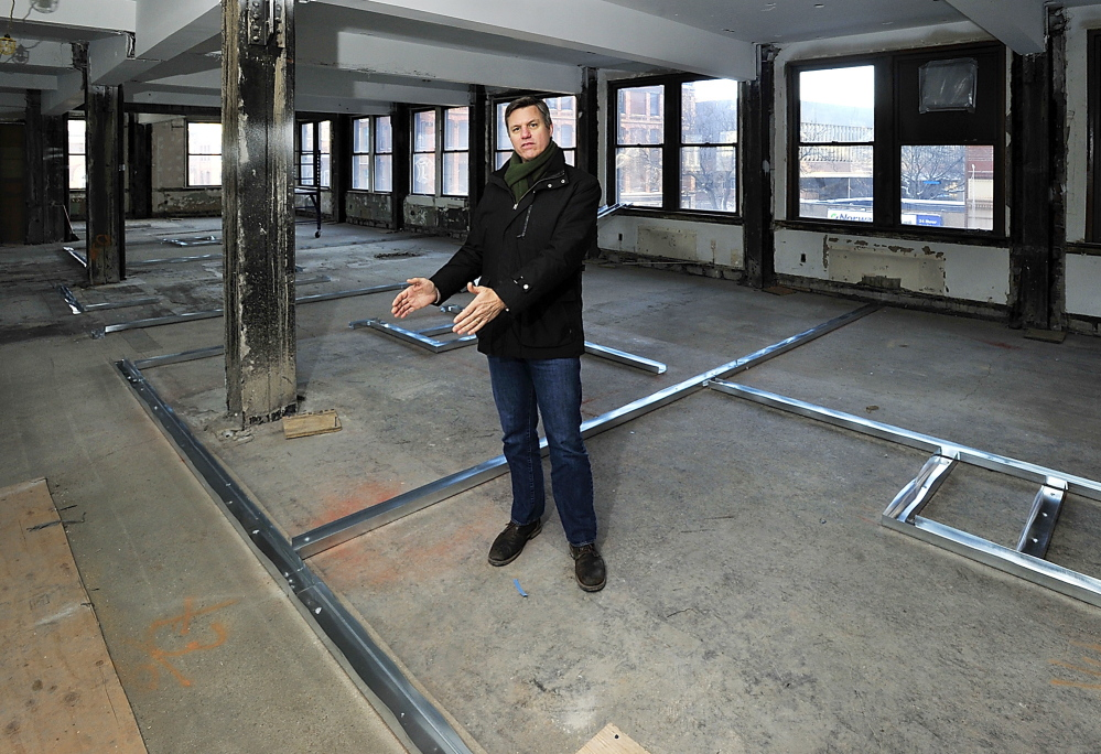 Developer Jim Brady shows where the first hotel room will be built on the second floor of the former Portland Press Herald building on Monday.