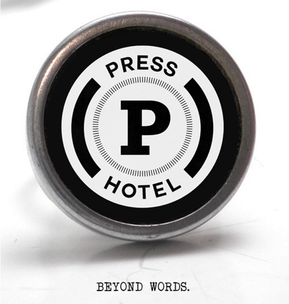 The Press Hotel logo is taken from the image of a typewriter key, in keeping with the newspaper theme.
