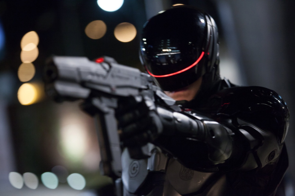 "Joel Kinnaman is the cop who is reborn inside the suit of a cyborg in ""RoboCop."""