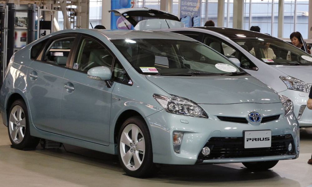 Toyota will recall 1.9 million Prius hybrids sold from 2010 through 2014 model years to update software in the electronic controls of the car.