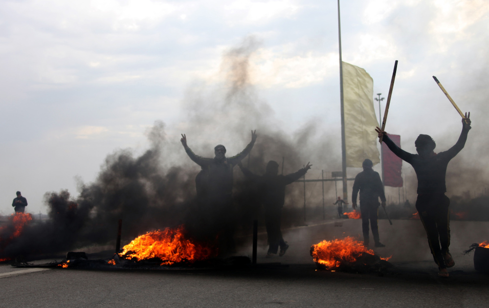 Sunnis burn tires to block the highway to Jordan and Syria, outside Fallujah, Iraq, in this Dec. 30 file photo. The militants are testing the government's ability to maintain security.