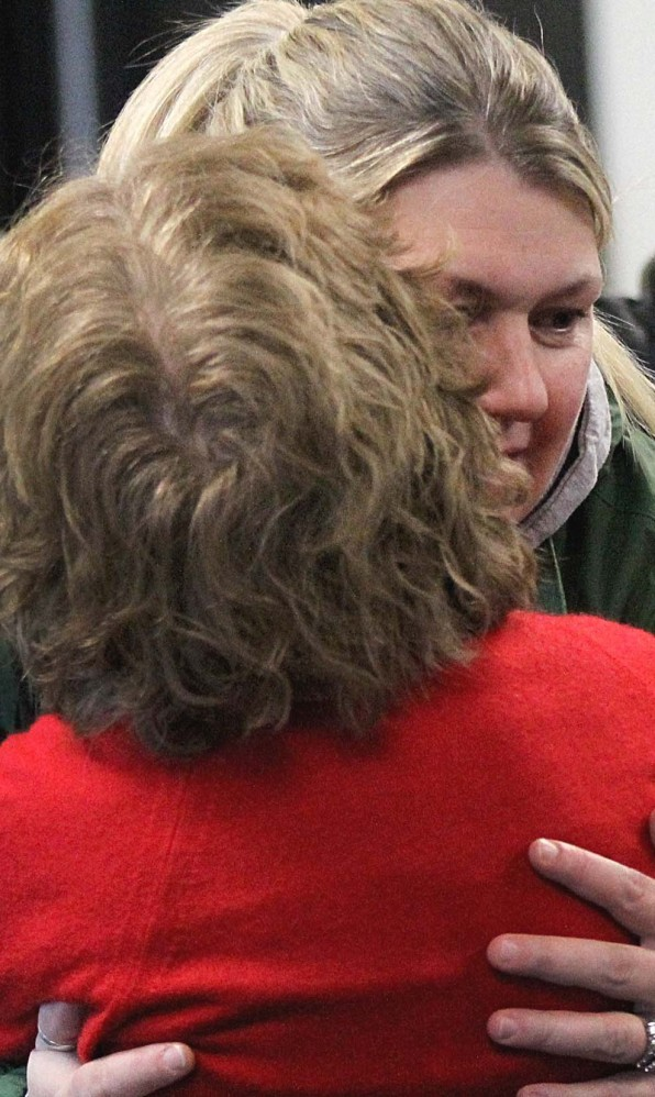 Friends of Irish nanny Aisling Brady McCarthy embrace after her bail hearing Friday in Woburn, Mass. McCarthy is charged in the 2013 death of 1-year-old Rehma Sabir of Cambridge, Mass.