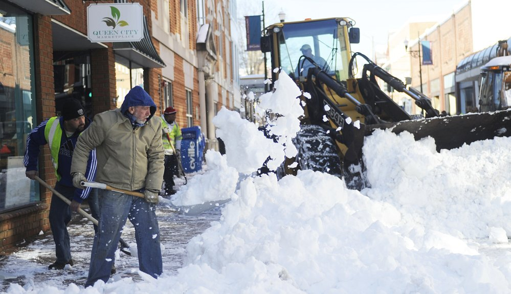 Inmates from Middle River Regional Jail help city of Staunton, Va., workers clear a downtown street of snow Friday, after the storm that barreled up the East Coast.
