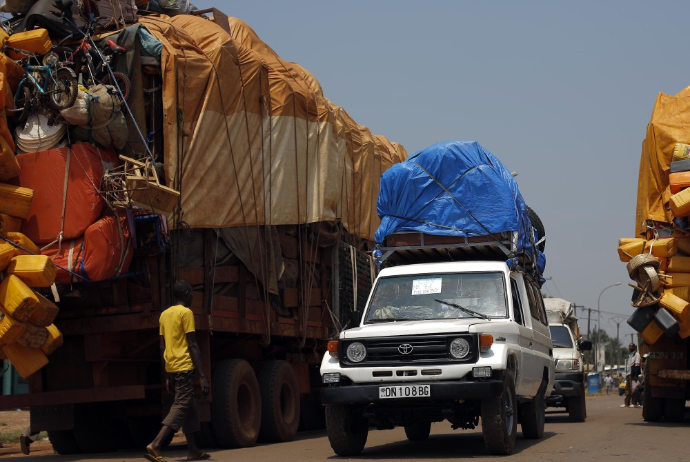 A convoy of Muslims fleeing Bangui, Central African Republic, is turned around by peacekeepers Friday.