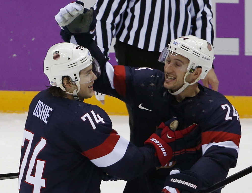 USA forward T.J. Oshie is congratulated by forward Ryan Callahan after scoring the winning goal in a shootout against Russia in a men's hockey game at the 2014 Winter Olympics on Saturdayin Sochi, Russia. The USA won 3-2.