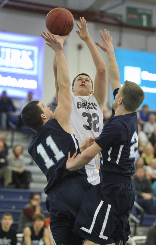 Greely's #32, Kyle Wood, pulls up for a jumper over York's #11, Mark MacGlashing, and #24, Adam Legg.