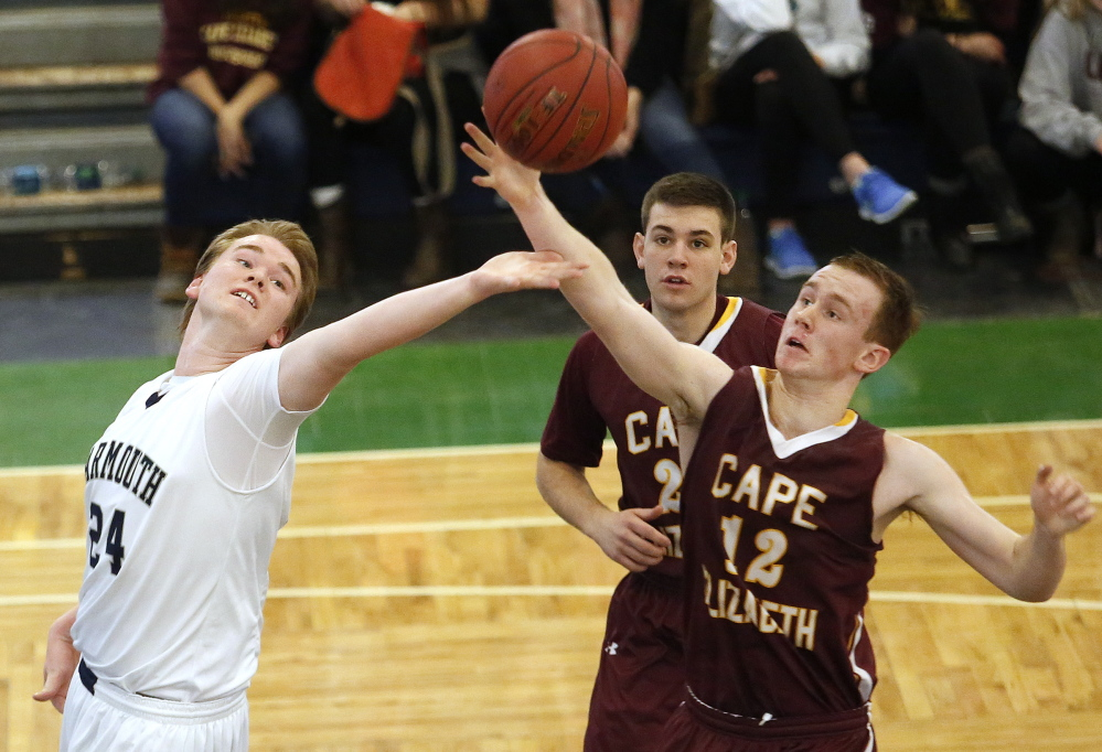 Ethan Gage, left, of Yarmouth contends for a rebound with Quinn Hewitt of Cape Elizabeth as John Hall of the Capers watches Saturday during Yarmouth's 45-43 victory in a Western Class B quarterfinal at the Portland Expo. Yarmouth will meet top-ranked Greely in the semifinals Thursday night.
