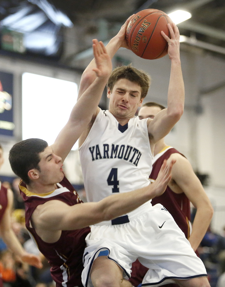 David Murphy of Yarmouth drives the lane and draws contact from Justin Guerette of Cape Elizabeth.