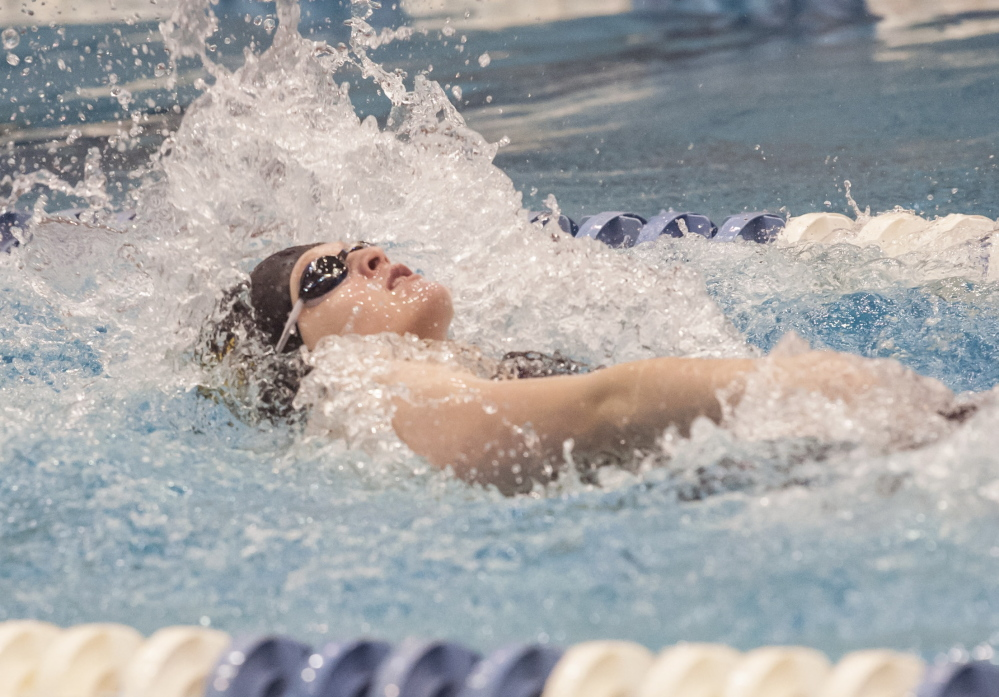 Sarah Nappo of Cheverus competes in the 100-yard backstroke finals Saturday at the Wallace Pool at the University of Maine. Nappo won the event and and anchored the concluding 400 freestyle relay that clinched the championship.
