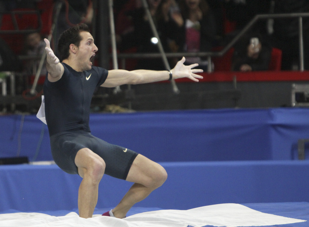 """France's Renaud Lavillenie celebrates after setting a world indoor record of 6.16 meters, at the """"Pole Vault Stars"""" event at Donetsk in eastern Ukraine, Saturday. Lavillenie broke Sergei Bubka's 21-year-old indoor pole vault world record."""