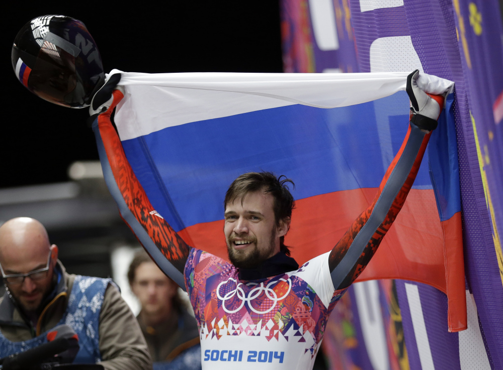 Alexander Tretiakov of Russia celebrates in the finish area after he won the gold medal during the men's skeleton competition at the 2014 Winter Olympics, Saturday in Krasnaya Polyana, Russia.