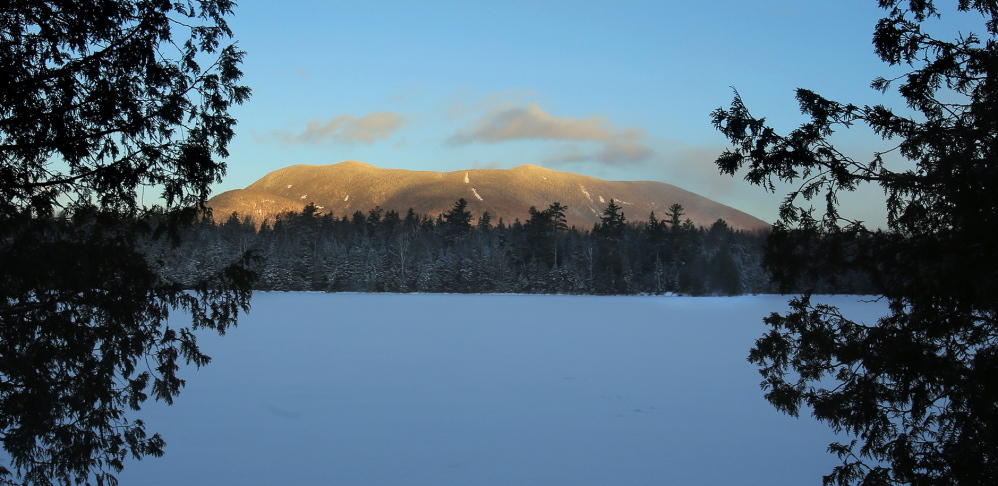 Baker Mountain is coated with a new dusting of snow lit up by a rising sun Jan. 26.