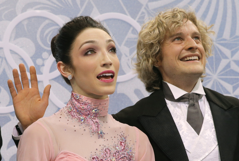 Meryl Davis and Charlie White of the United States wait in the results area after competing in the ice dance short dance figure skating competition at the Iceberg Skating Palace during the 2014 Winter Olympics Sunday in Sochi, Russia.