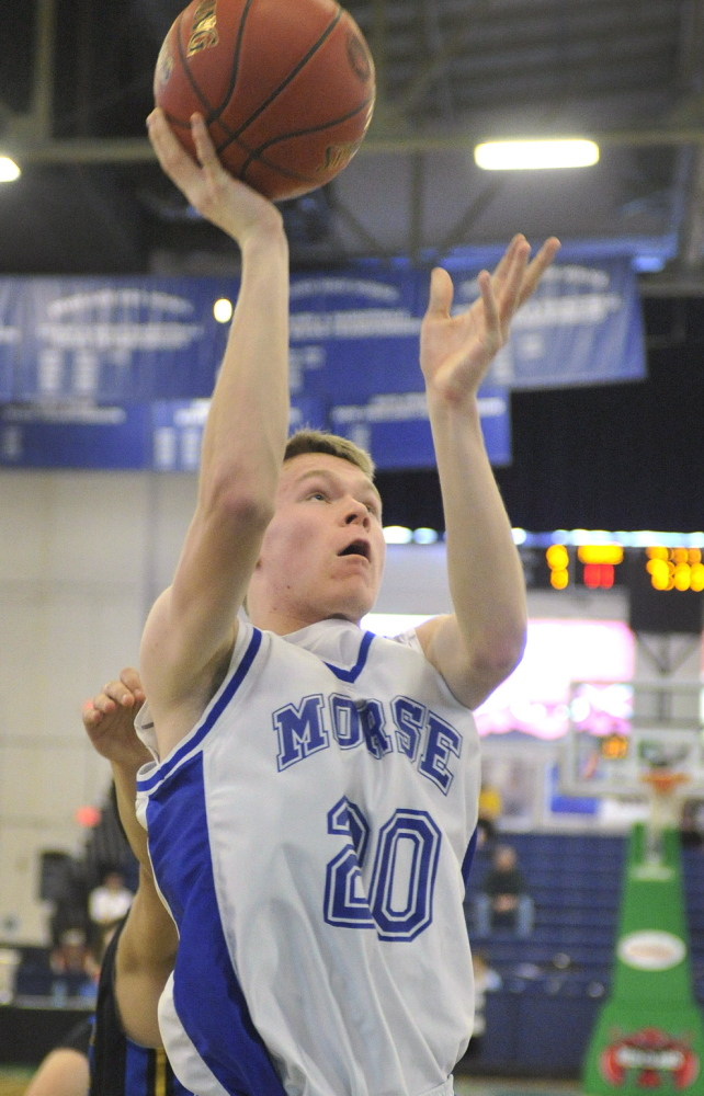Morse's Ethan Winglass puts up a short jumper during Saturday's double-OT victory over Lake Region in the Western Class B quarterfinals.
