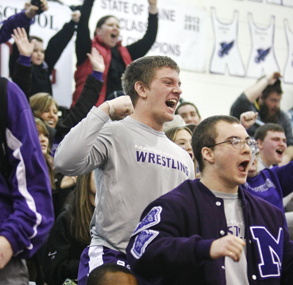 Marshwood fans celebrate during the Class A state wrestling tournament at Noble High School in North Berwick on Saturday.