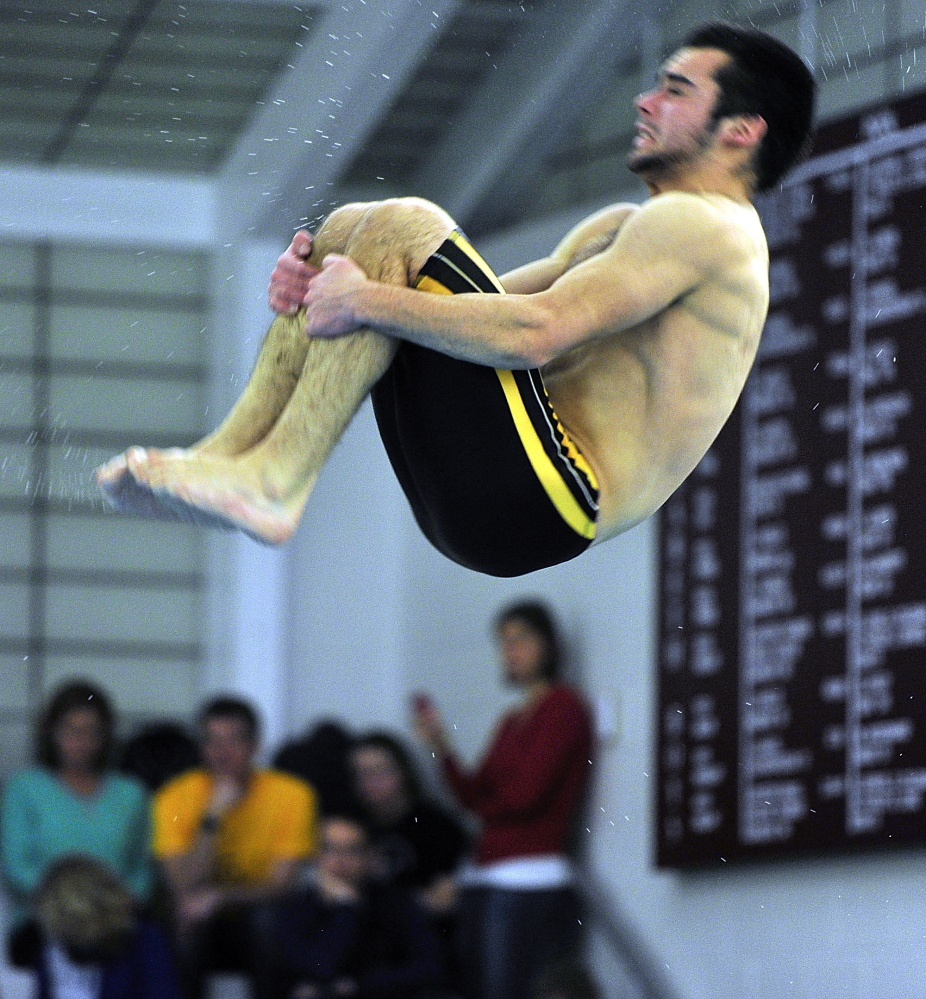 """Cheverus diver Nick Jensen does a double somersault at the Southwesterns North championships. Jensen has """"a lot of talent and a lot of determination,"""" said coach Mike Hartley."""