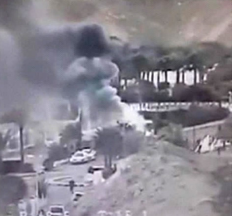 Image from a video provided by the Israeli Airports Authority shows smoke from the bombing of a bus carrying South Korean sightseers near the tip of the Gulf of Aqaba.