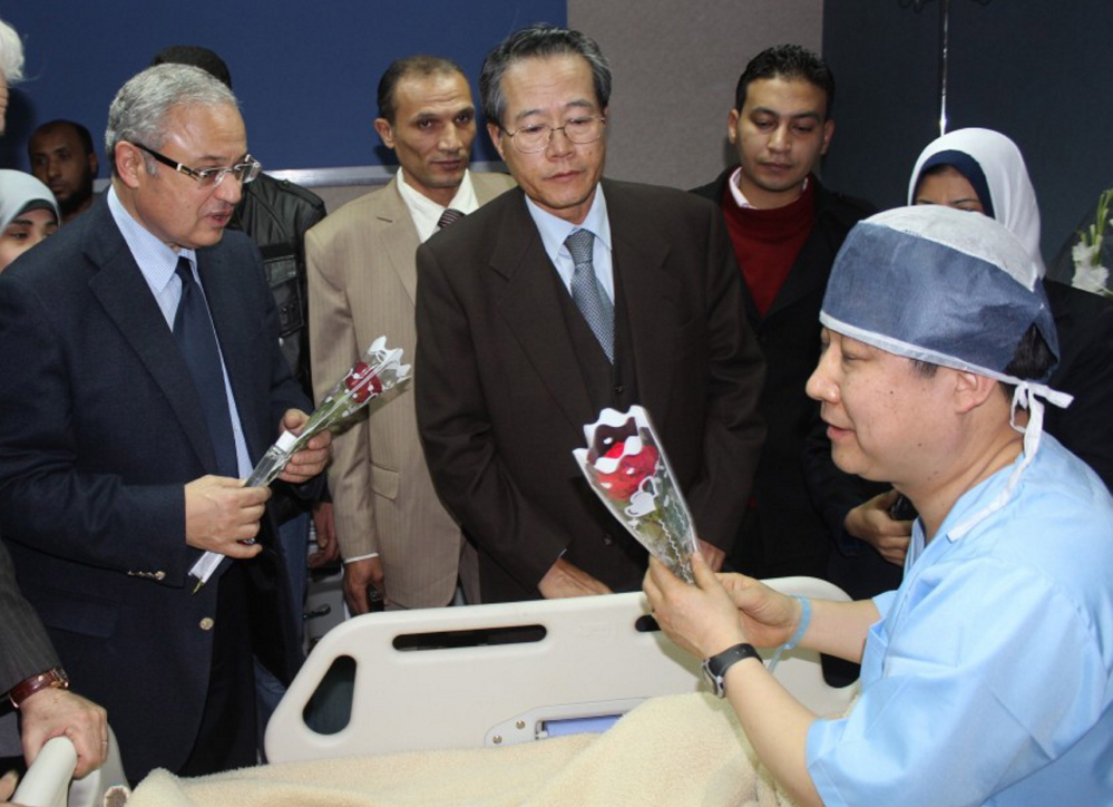 Egyptian tourism minister Hesham Zazou, left, and South Korea's ambassador to Cairo, center, visit a Korean tourist who was injured during an explosion that targeted a tourist bus, as he received medical treatment in Sharm el-Sheik hospital.