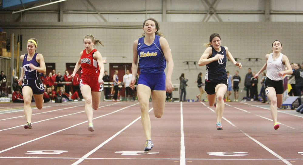 Kate Hall of Lake Region wins the 55-meter dash Monday at the Class B indoor track and field championships at Bates College. Hall set meet records in the 55, 200 and long jump.