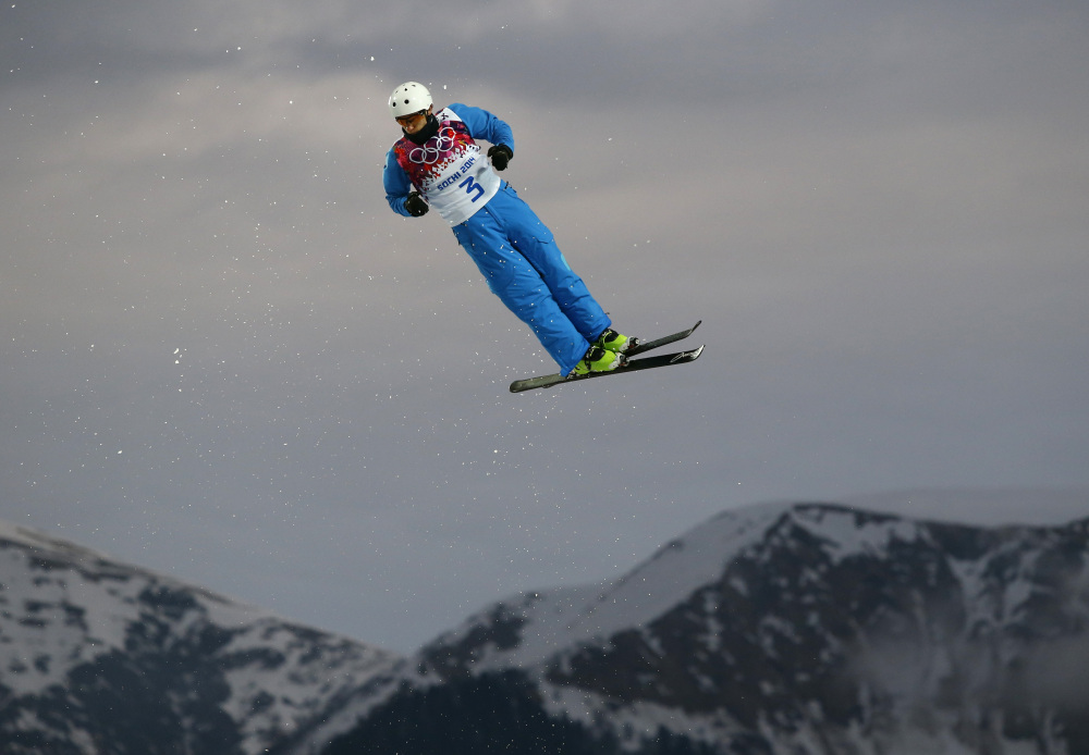 Anton Kushnir of Belarus jumps during men's freestyle skiing aerials qualifying at the Rosa Khutor Extreme Park, at the 2014 Winter Olympics on Monday in Krasnaya Polyana, Russia.
