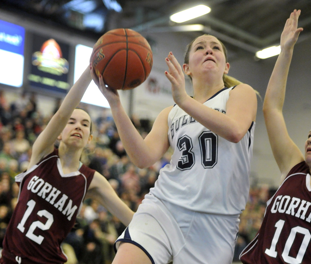 Portland's Brianna Holdren drives for a key breakaway basket in the closing seconds against Gorham to secure a 47-42 win in a Western Class A girls' basketball quarterfinal at the Portland Expo.