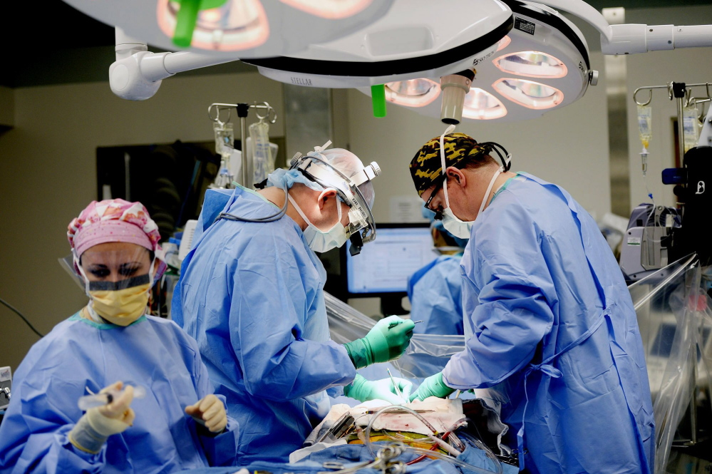 A medical team performs surgery at Maine Medical Center in Portland this month.