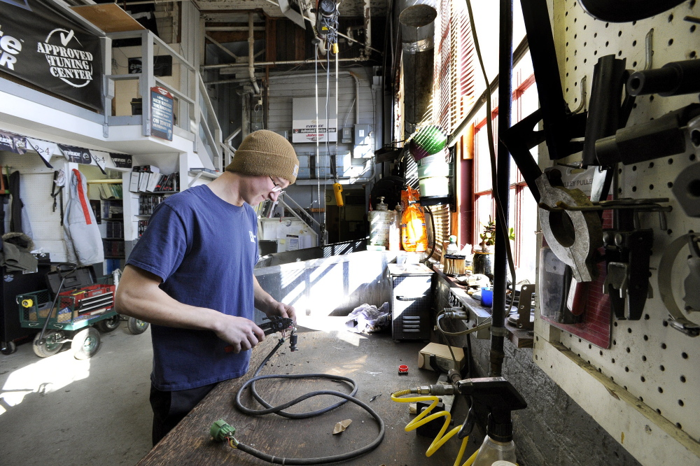Wesley Marean of Windham an outboard mechanic at Portland Yacht Services repairs a wiring : yacht wiring - yogabreezes.com