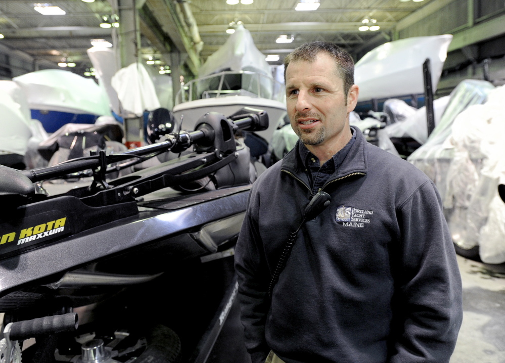 Jason Curtis, vice president of operations at Portland Yacht Services, discusses his company's innovative solution to the shortage of diesel mechanics, in Portland on Wednesday.