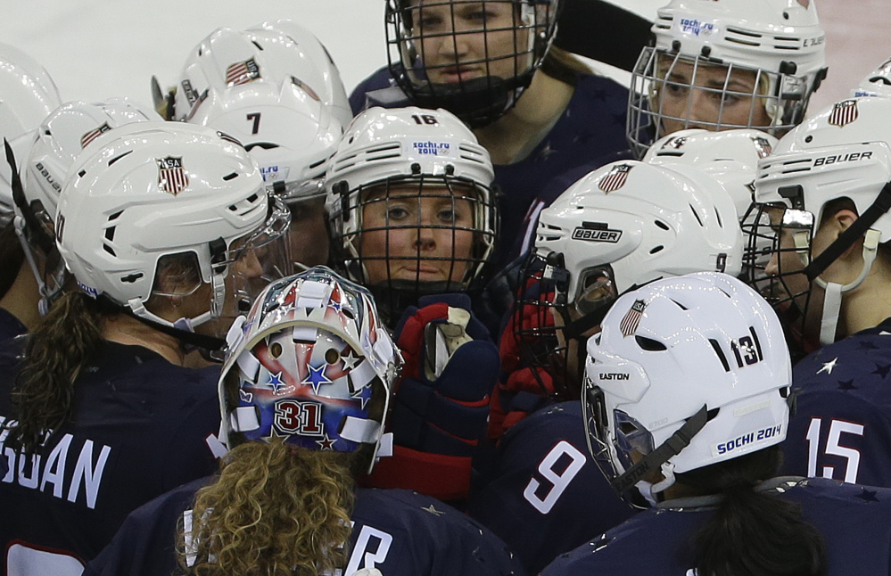 Team USA gathers at mid ice after defeating Sweden 6-1 during a 2014 Winter Olympics women's semifinal ice hockey game at Shayba Arena on Monday in Sochi, Russia.