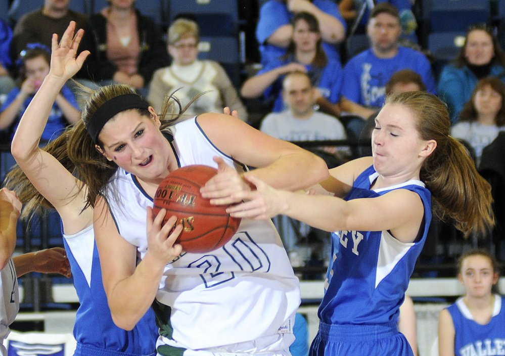 Blayke Morin of Rangeley tries to fight through Valley's defenders Kirsten Mathieu, right, and Haven Mayhew during their Western Class D girls' basketball quarterfinal Monday at the Augusta Civic Center. Second-seeded Rangeley rolled to a 69-24 win.