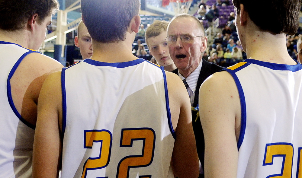 Boothbay Region coach I.J. Pinkham speaks with his players during a tournament basketball match up Monday against Hall-Dale High School in Augusta.