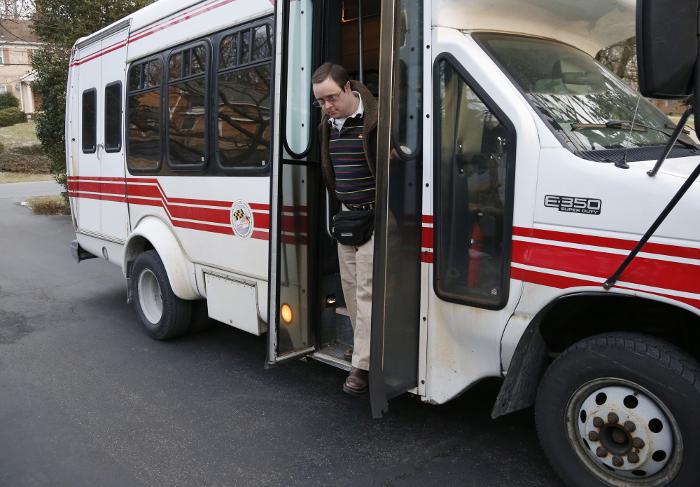 Matthew McMeekin gets off a bus at his home in Bethesda, Md., after a day of work. McMeekin has spent 14 years working at the nonprofit Rehabilitation Opportunities Inc.