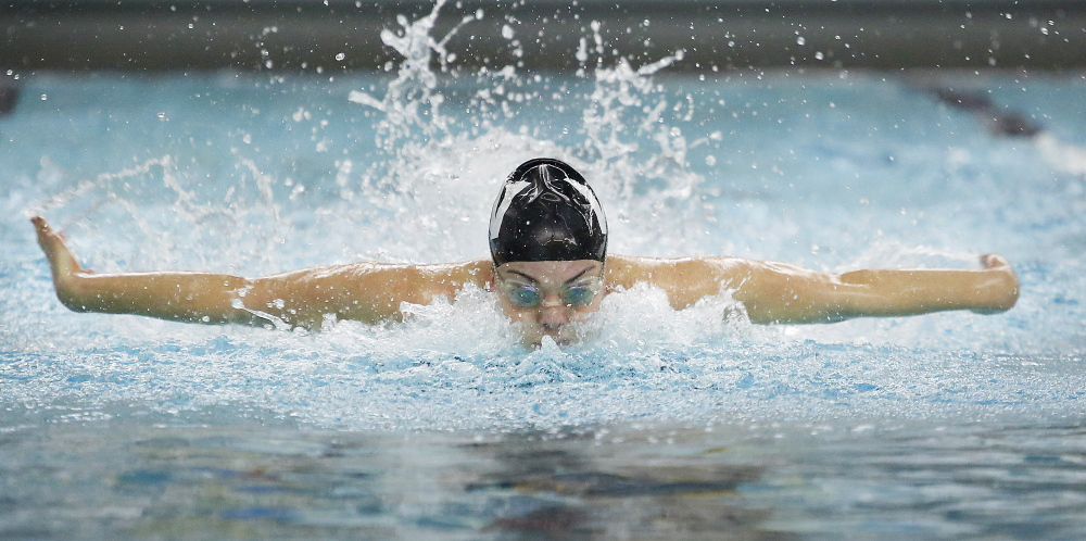 Colby Harvey of Waynflete heads toward a meet record of 54.97 seconds in the 100-yard butterfly Monday at the Class B girls' swimming and diving championships at Bowdoin College.