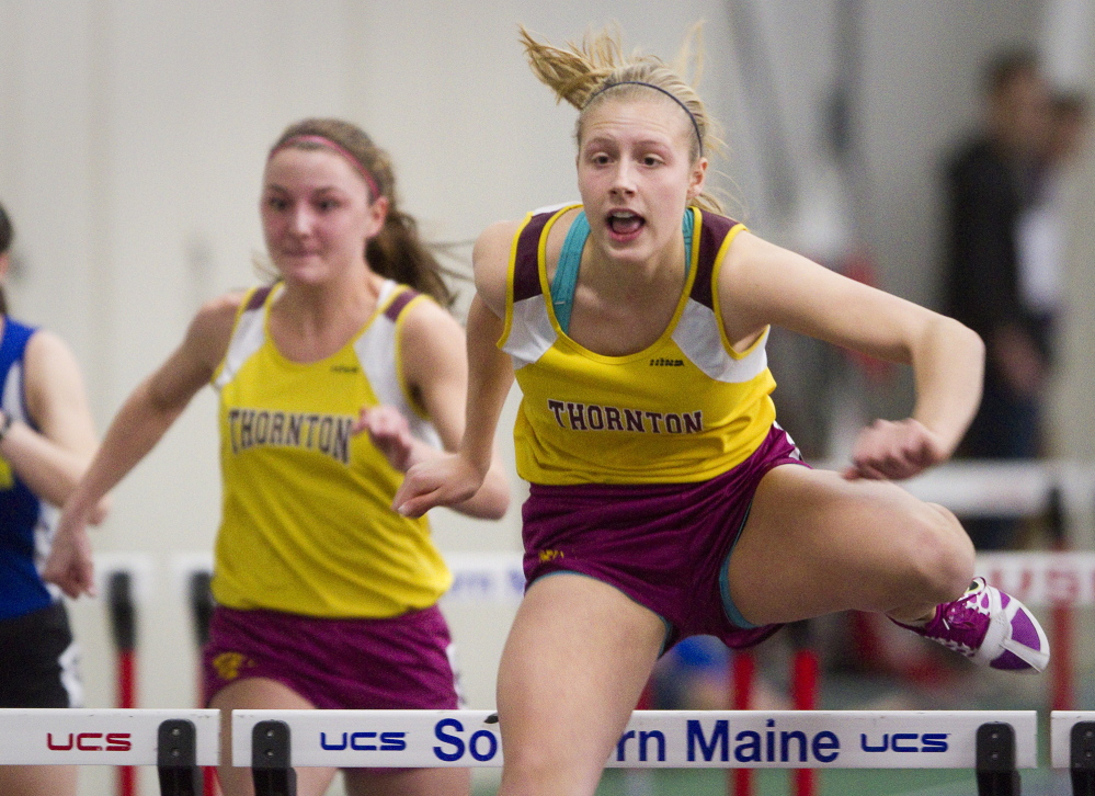 Tori Daigle of Thornton Academy clears a hurdles on her way to victory in the 55-meter hurdles Monday at the Class A indoor track and field championships. Daigle also set a meet record in the long jump, helping the Trojans earn the team title.