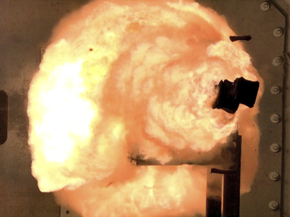 A high-speed camera captures the first full-energy shots from an electromagnetic launcher at a test facility in Dahlgren, Va.