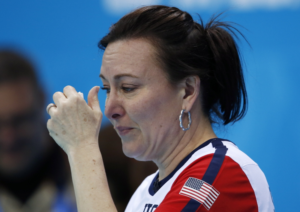 American Ann Swisshelm wipes away tears after losing to South Korea during women's curling competition against at the 2014 Winter Olympics on Monday in Sochi, Russia.