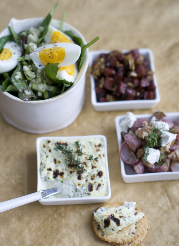 Cockwise from top right, seared maple kielbasa with raisins and sunflower seeds; butter-roasted radishes with dill, feta and walnuts; broiled herb ricotta; and soft boiled eggs with beet greens and apples.