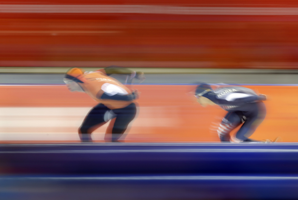 Sven Kramer of the Netherlands, left, and South Korea's Lee Seung-hoon compete in the men's 10,000-meter speedskating race at the Adler Arena Skating Center during the 2014 Winter Olympics in Sochi, Russia, Tuesday, Feb. 18, 2014.
