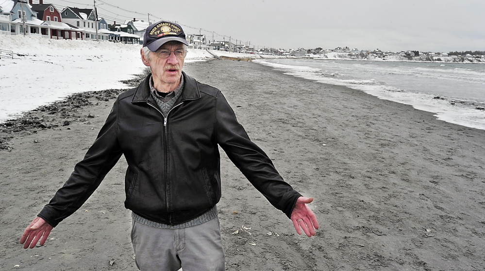 York Selectman Ron Nowell walks Tuesday along Long Sands Beach in York as he talks about the ramifications of not addressing private-property ownership along the shore.