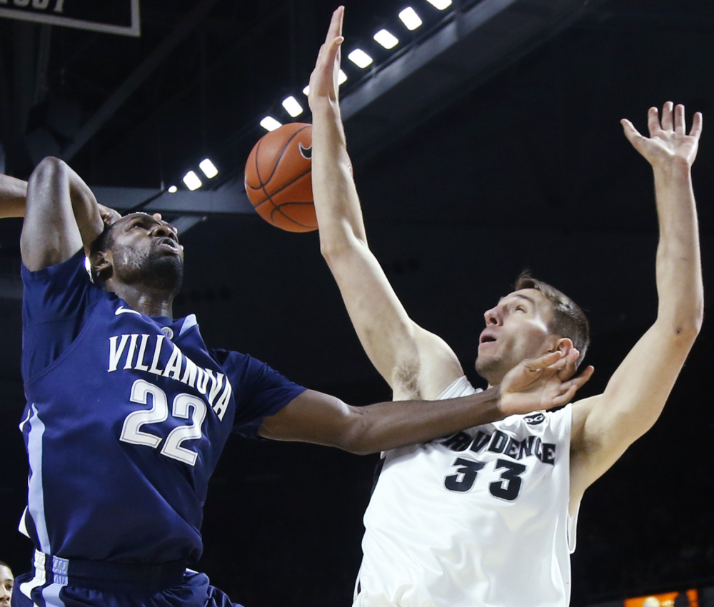 Villanova's JayVaughn Pinkston, left, is fouled by Providence's Carson Desrosiers during Tuesday's game. Pinkston had 20 points in a double-overtime Villanova win.