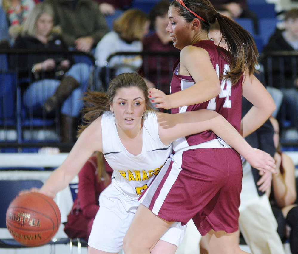 Sarah Clough dribbles around Faith Forsythe of Kents Hill during Maranacook's 52-39 win Tuesday in a Western Class C girls' basketball quarterfinal at the Augusta Civic Center.