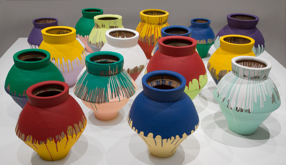 In this undated photo made available by the Brooklyn Museum of Art, shows a series of 16 vases that are part of an installation by Chinese artist Ai Weiwei and currently on display at the Perez Art Museum in Miami.