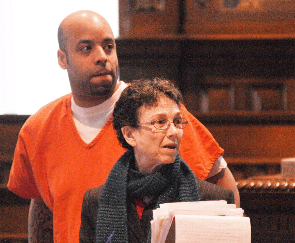 pharmacy robberies: Michael Pierce, 33, of Augusta, who was sentenced on two pharmacy robbery charges, stands with his attorney Sherry Tash on Wednesday at Kennebec County Superior Court in Augusta.