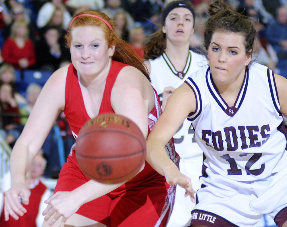 Cony's Rebecca Coniff, left, and Edward Little's Brooke Reynolds pursue a rebound Wednesday in an Eastern Class A girls' basketball semifinal at the Augusta Civic Center. Top-seeded Edward Little rolled to a 61-42 win.